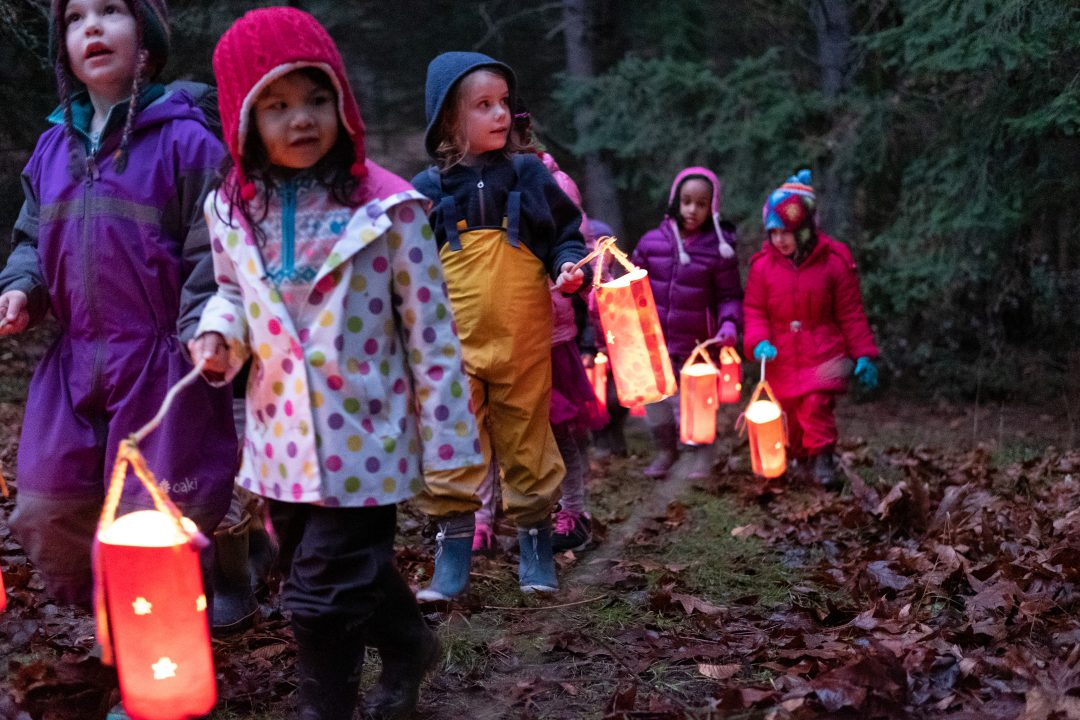 Students walking with lanterns