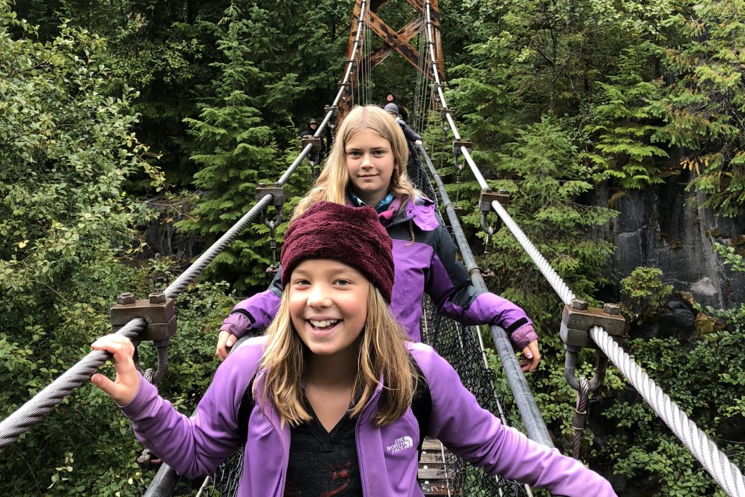 Students standing on a suspension bridge