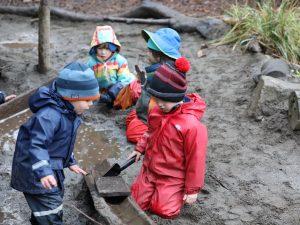 Preschool students building a waterway