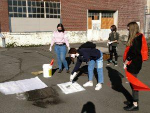 Students label storm drains
