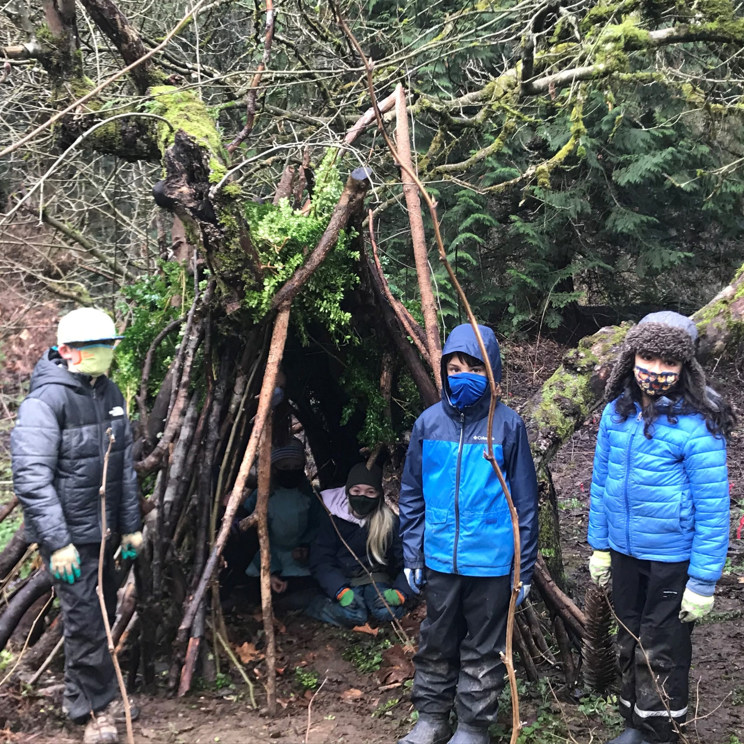 Students creating an outdoor shelter